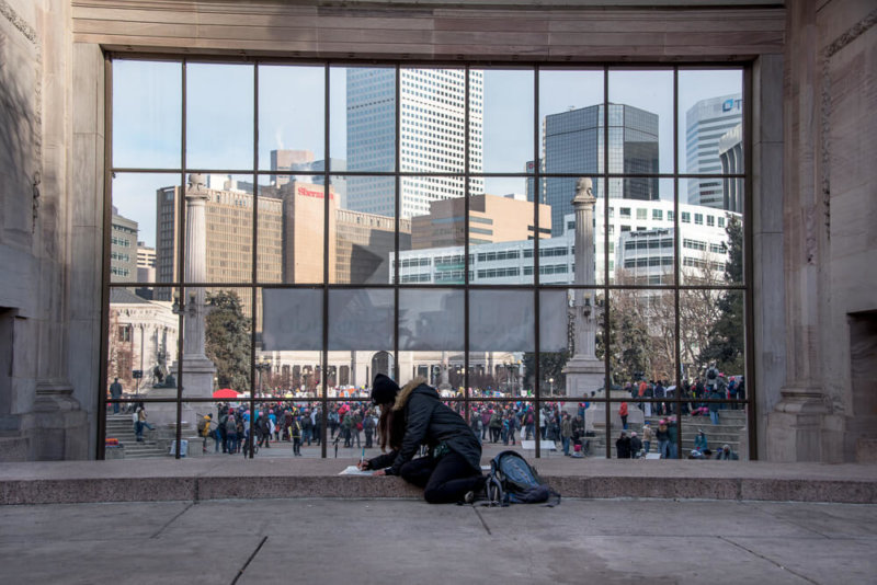 View of Denver - Girl Making Sign