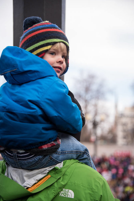 Little Boy on Dad's Shoulders in Blue Jacket